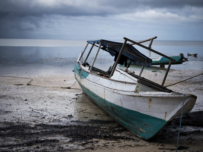 Local fishing boat waiting for high tide
