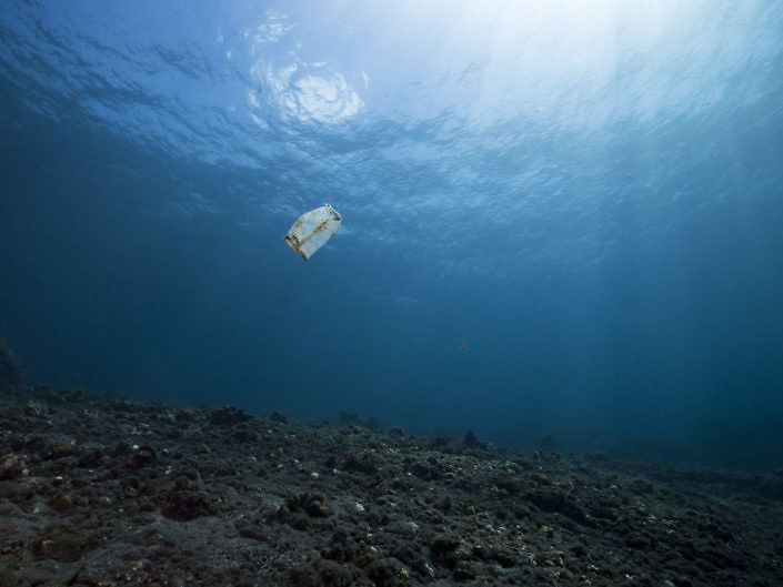 Plastic bag floating on an empty reef in Indonesia.