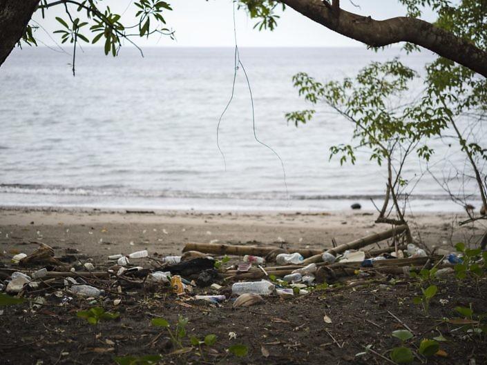 Plastic littering a remote beach in Indonesia.